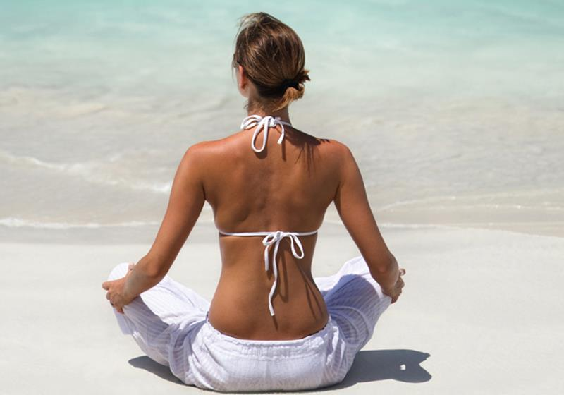 Relaxing on a pristine, uncrowded Virgin Gorda beach to practice yoga